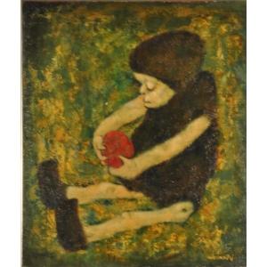 Bambola con mela rossa